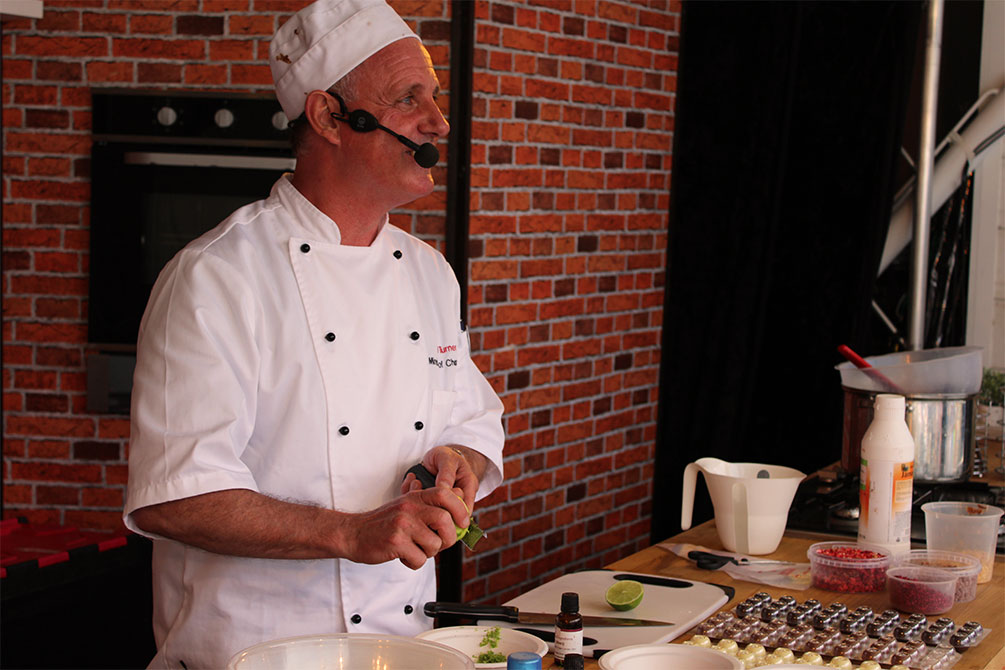Carl Turner doing a chocolate making demonstration on stage
